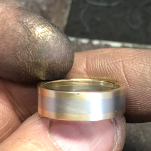 Bespoke mans wedding band being worked on