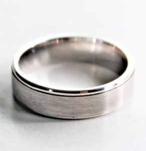 Mens wedding ring with edging detail in a brushed finish
