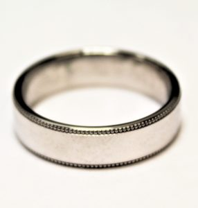 Mens wedding ring with edging detail