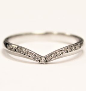 Shaped wedding ring with diamonds