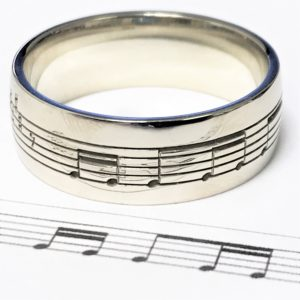 Musical notes engraved wedding ring