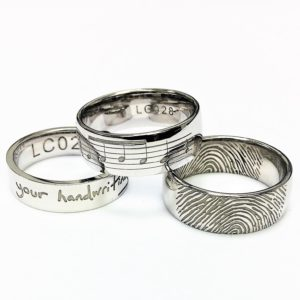 Personalised wedding rings - music, handwriting, thumb print